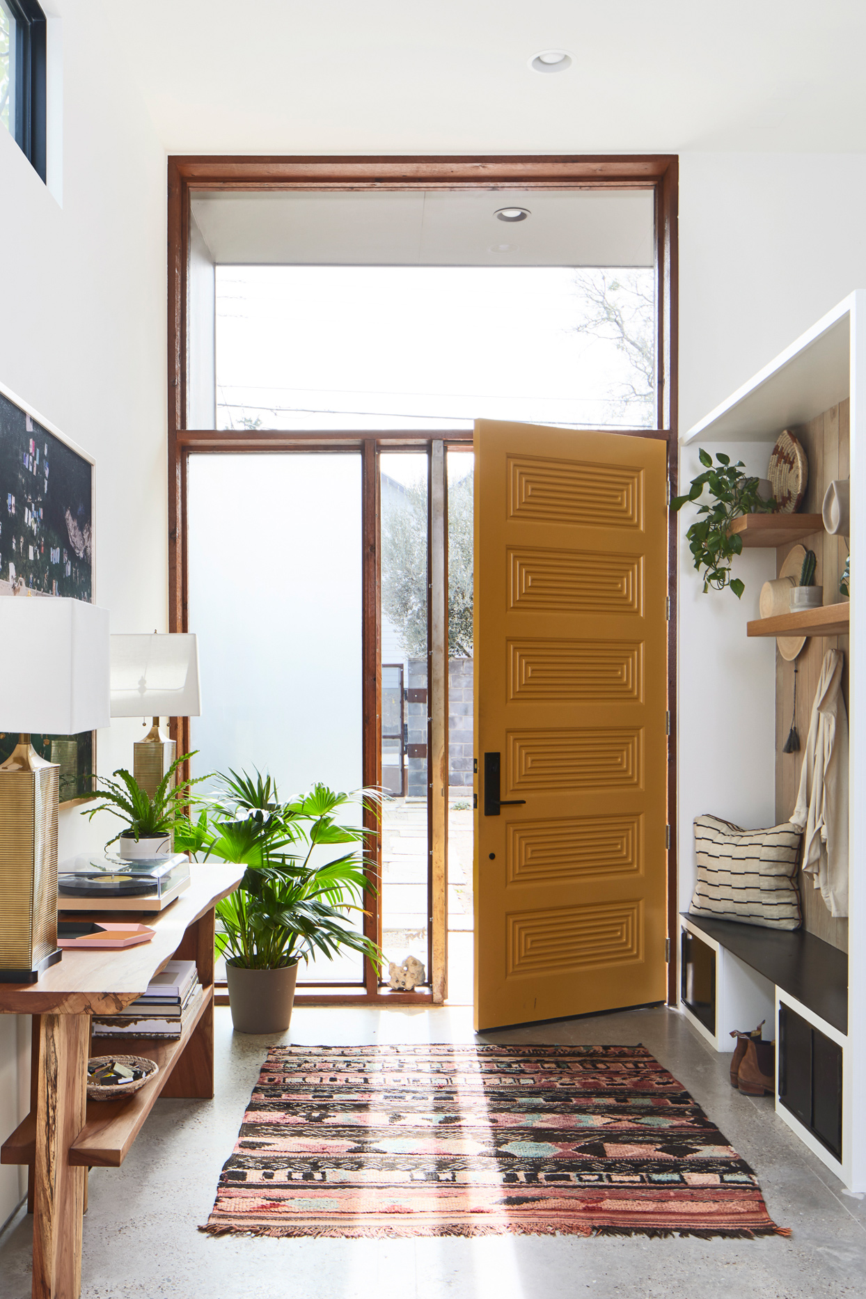 entryway with yellow grooved front door