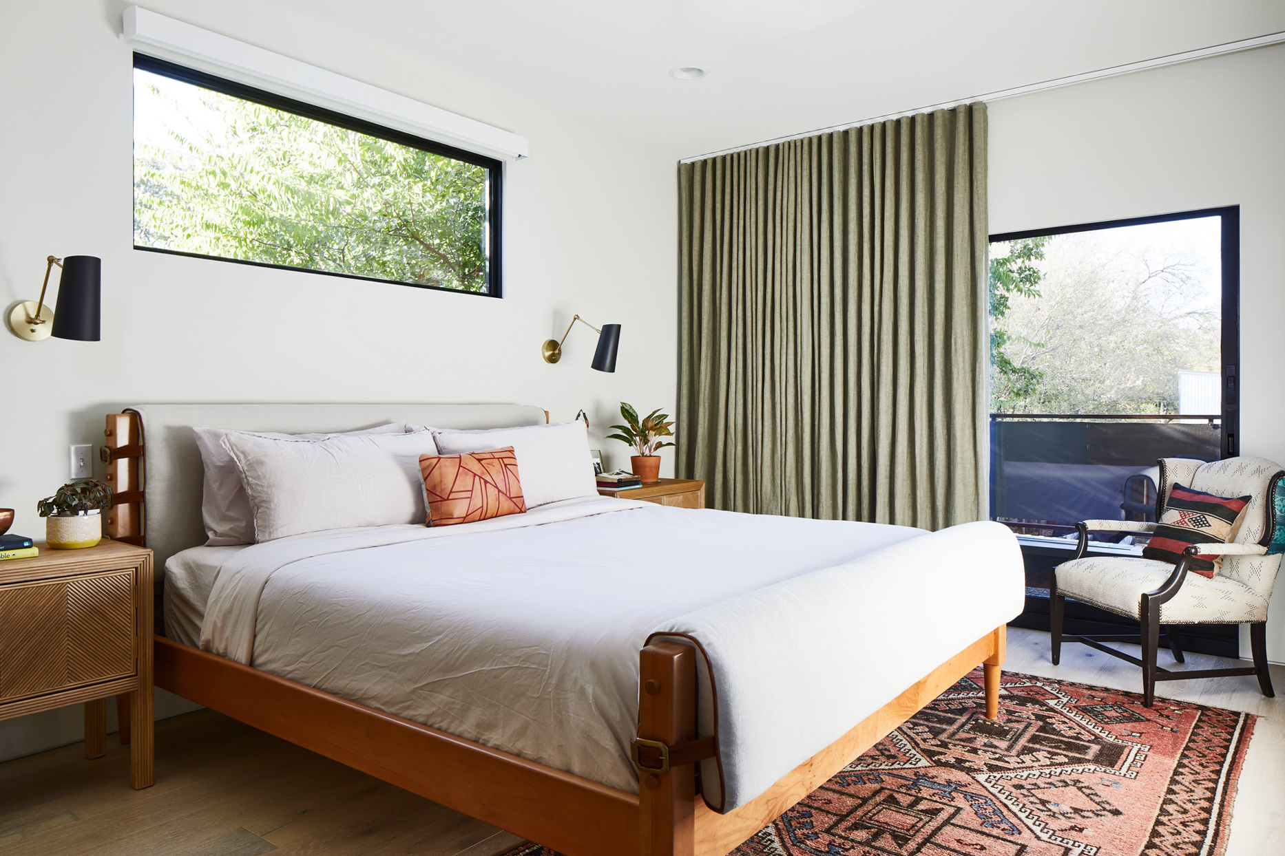 neutral-colored master bedroom with wood accents