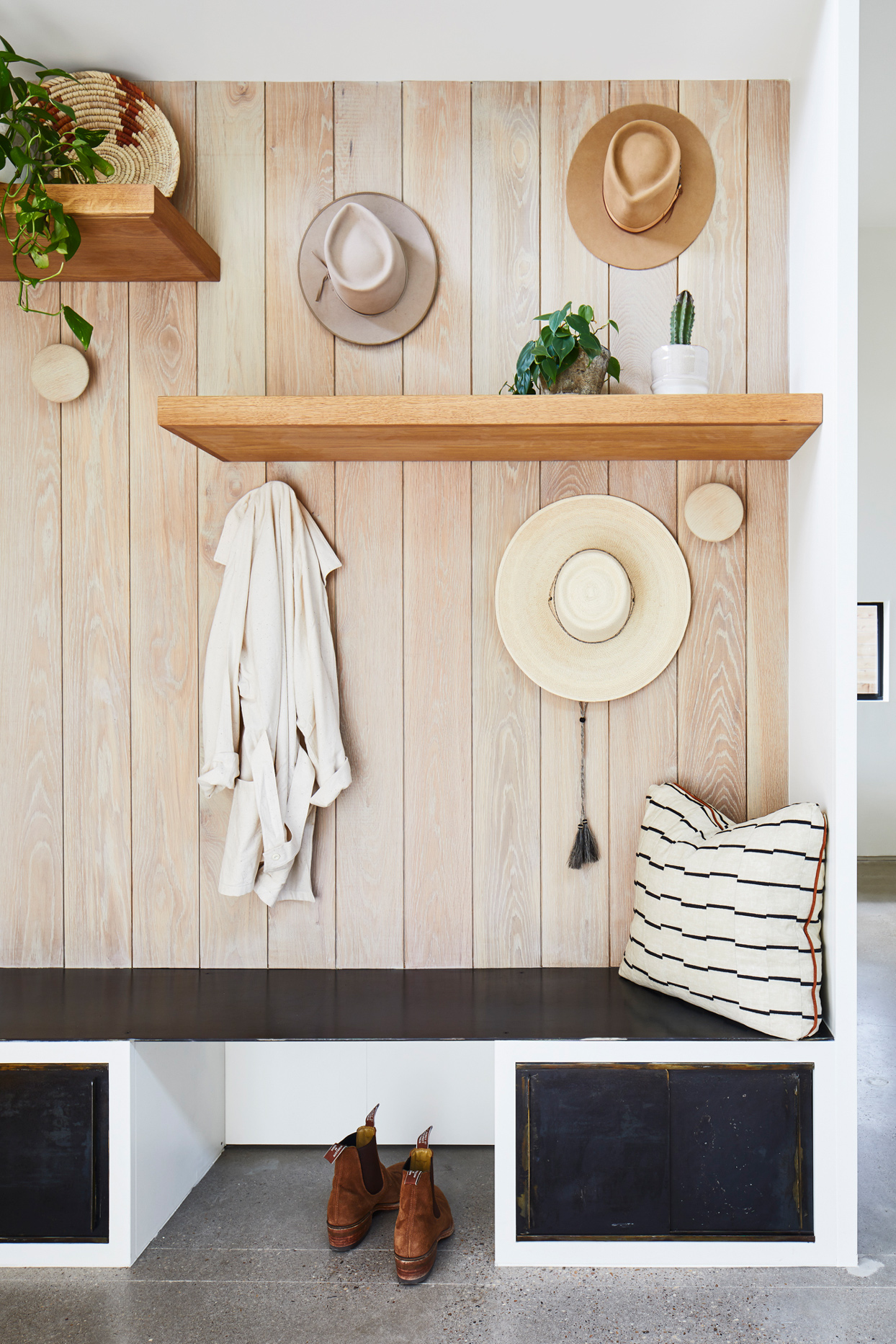 wood panel wall featuring floating shelves