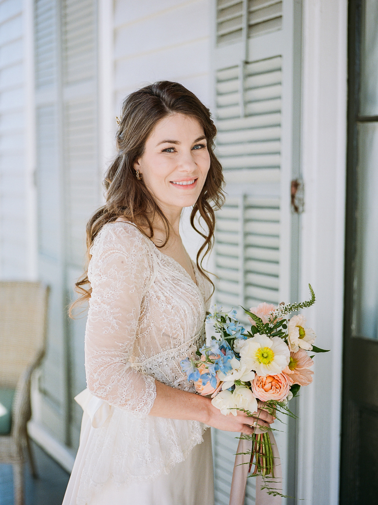 bride wearing lace three-quarter sleeve wedding dress