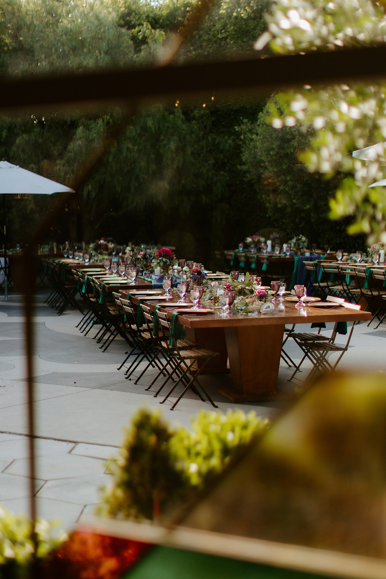 outdoor wooden reception tables with jewel tones decorations
