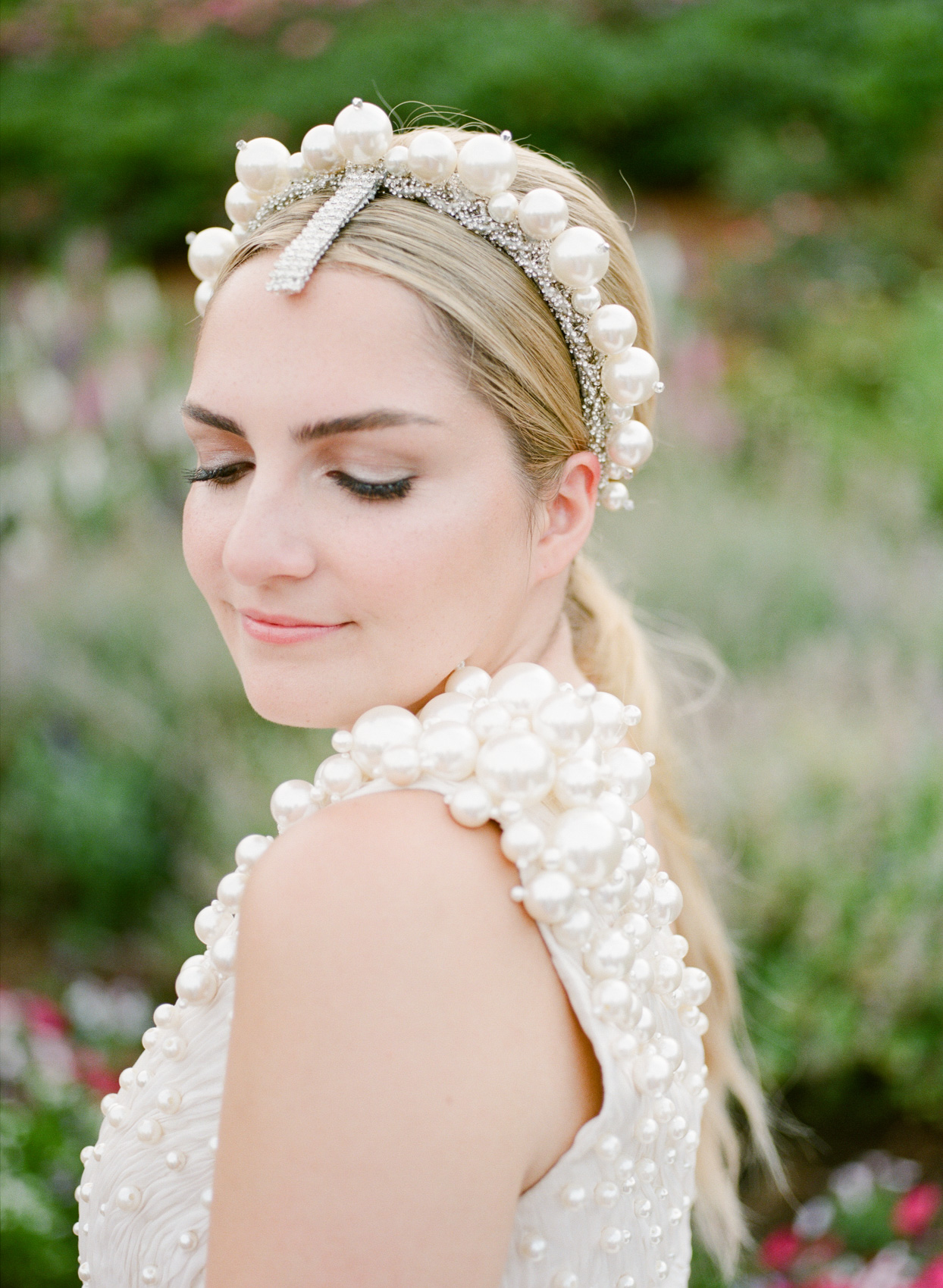bride in pearl studded dress and headpiece for rehearsal dinner