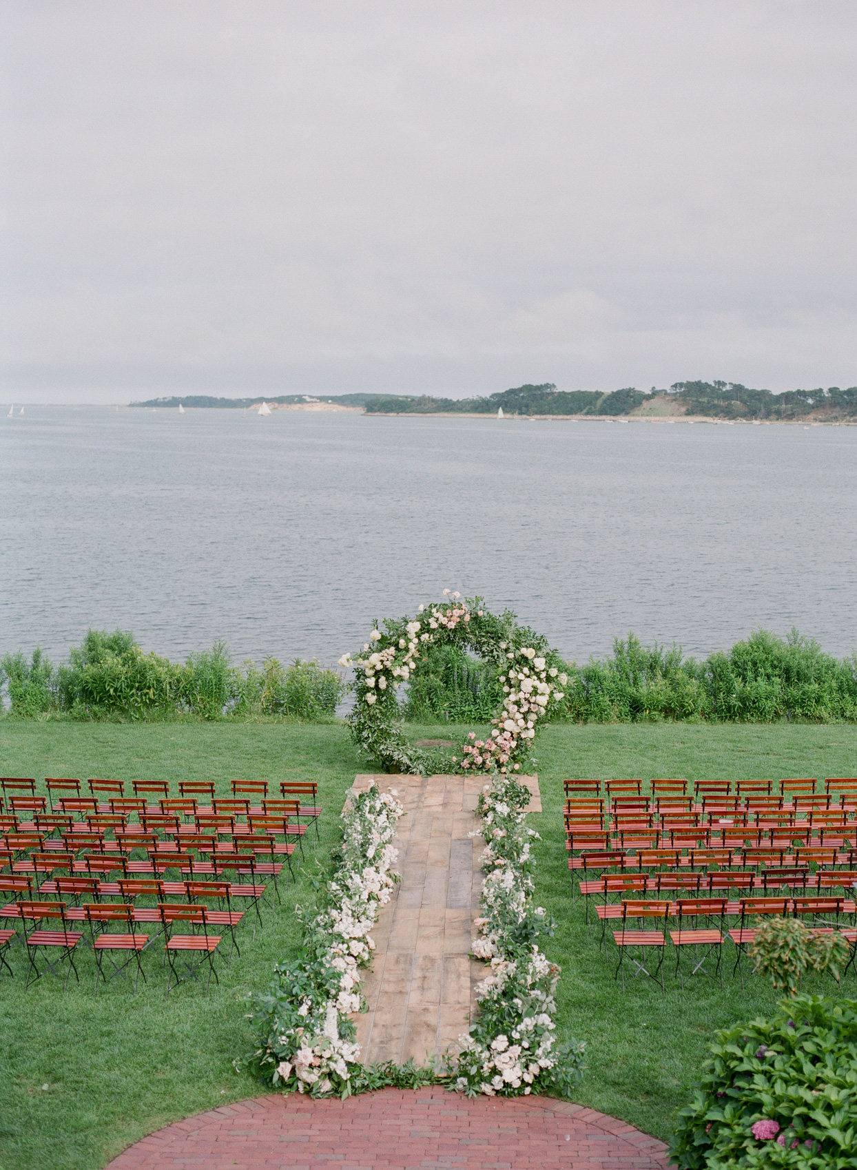 outdoor wedding ceremony spice on grass by water