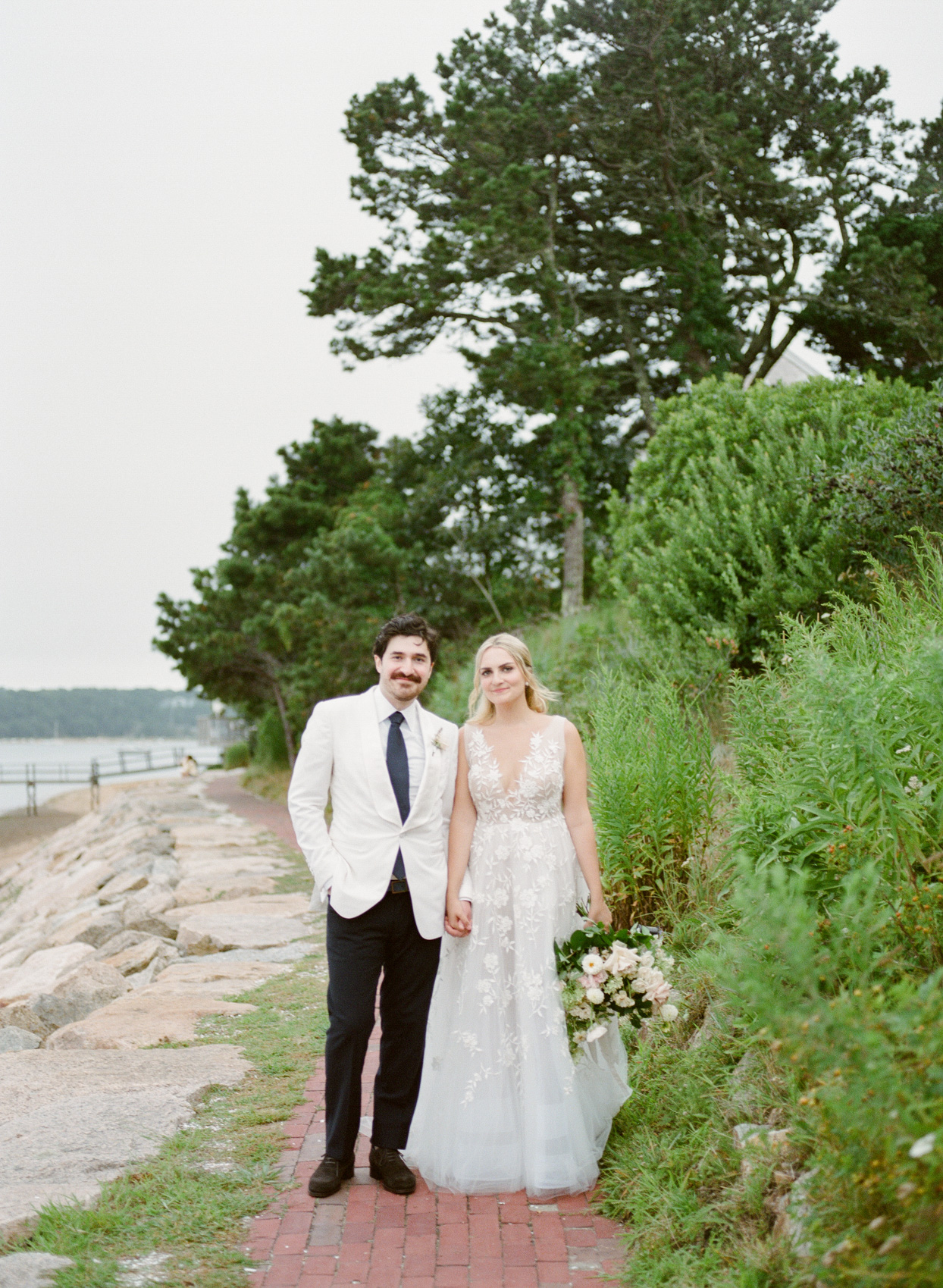 wedding couple portrait on walkway by water