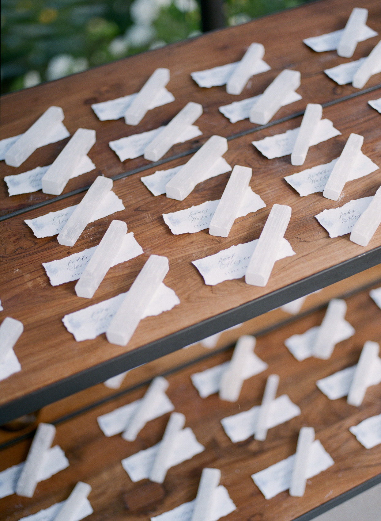 wooden table of wedding escort cards