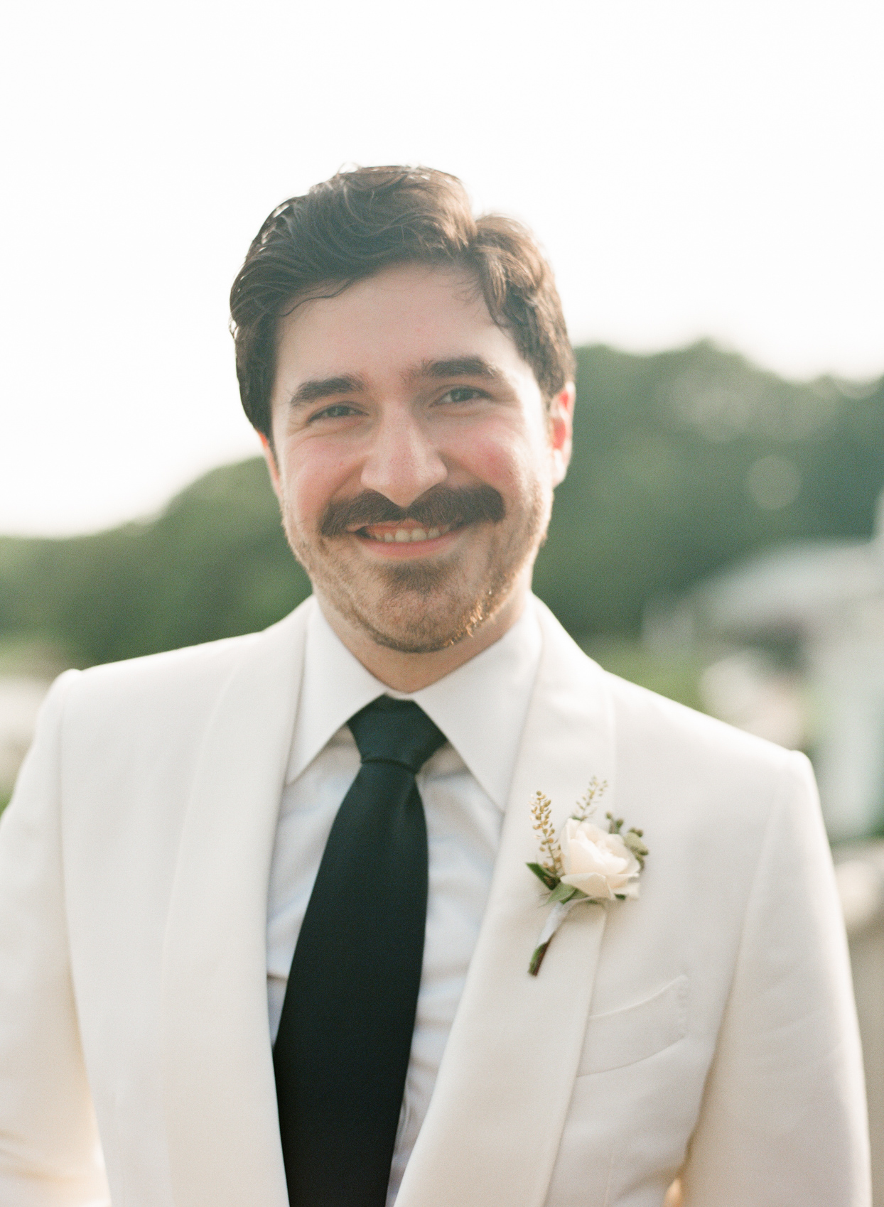 wedding groom portrait in black and white suit