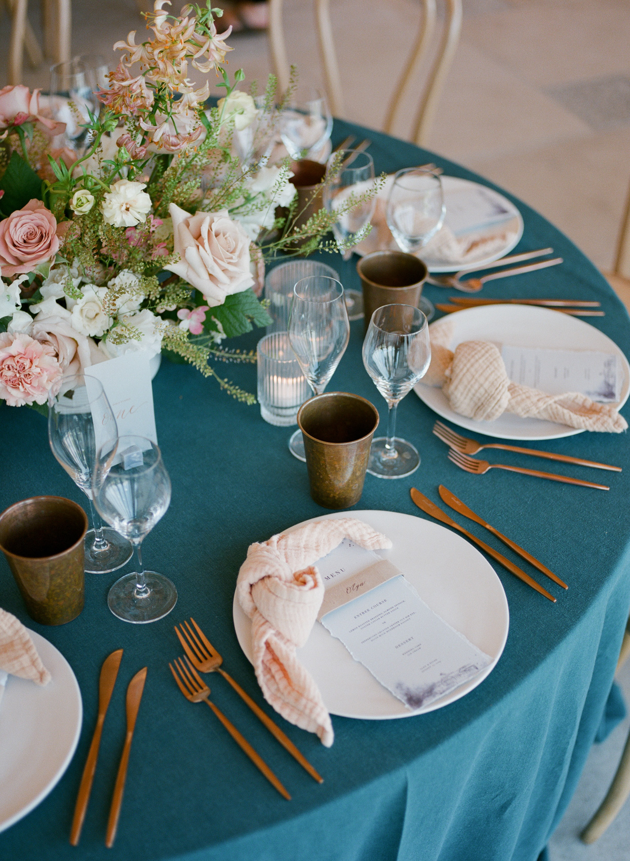 wedding reception round blue and pink decorated tables