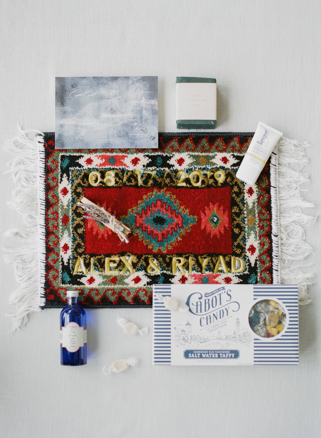 wedding welcome box with taffy, rose water, rug, rug, soap, sunscreen, and map