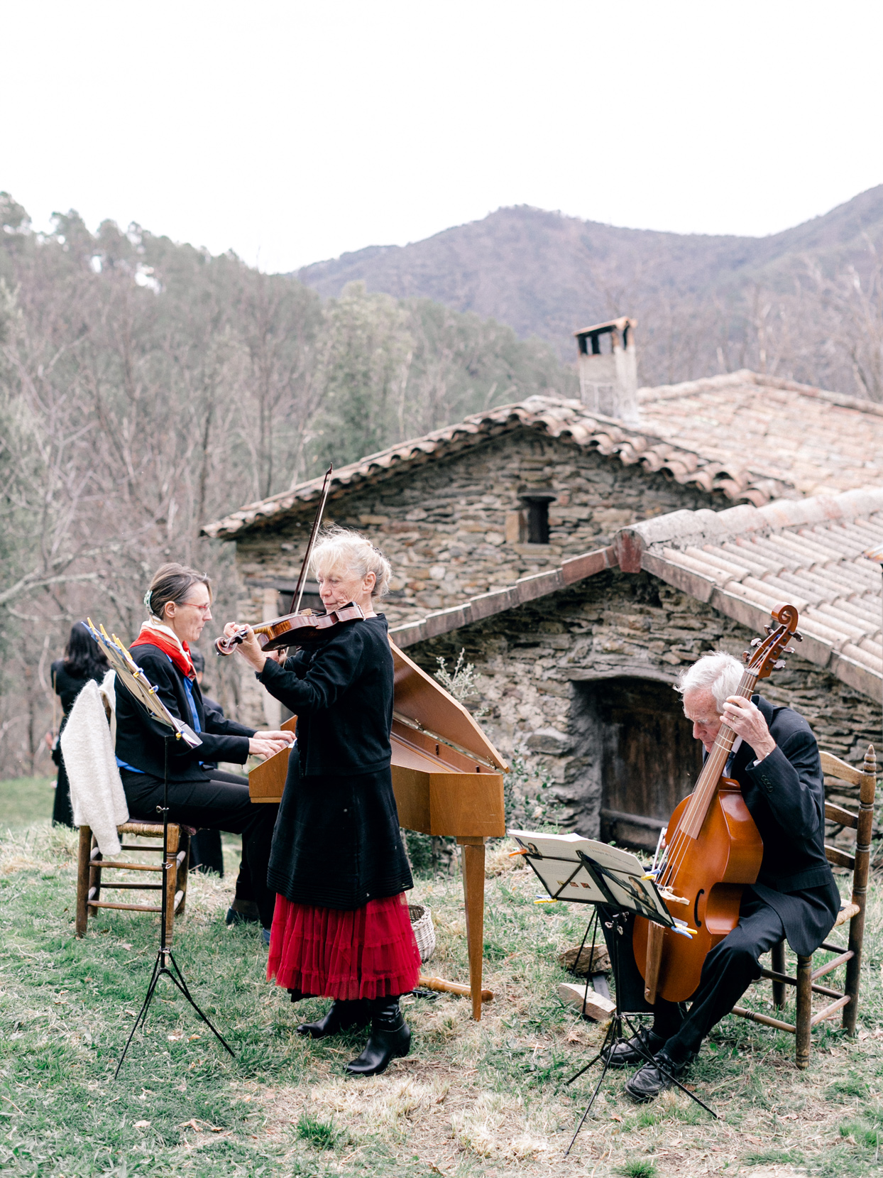 wedding ceremony musicians playing on french country hillside