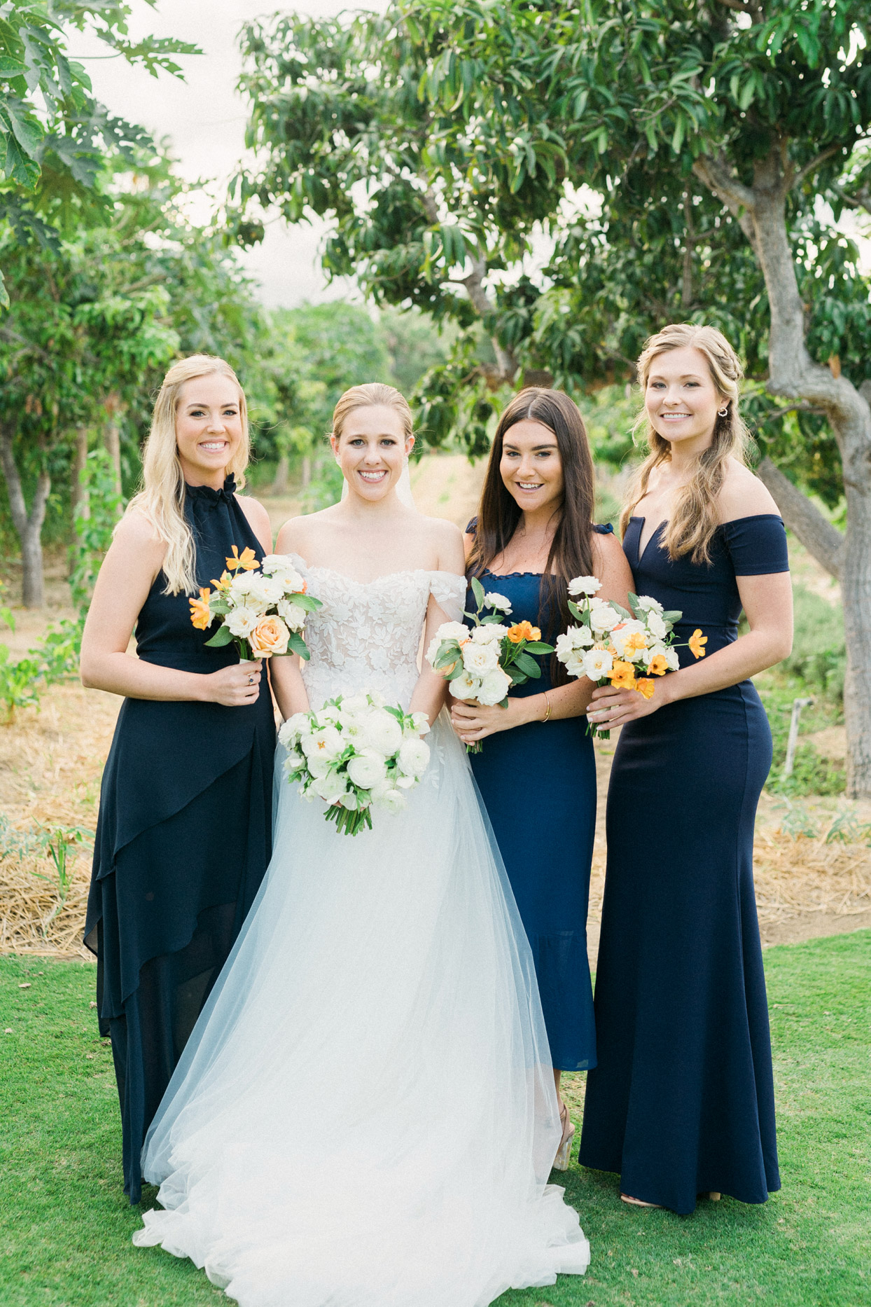 bride with bridesmaids in large blue dresses
