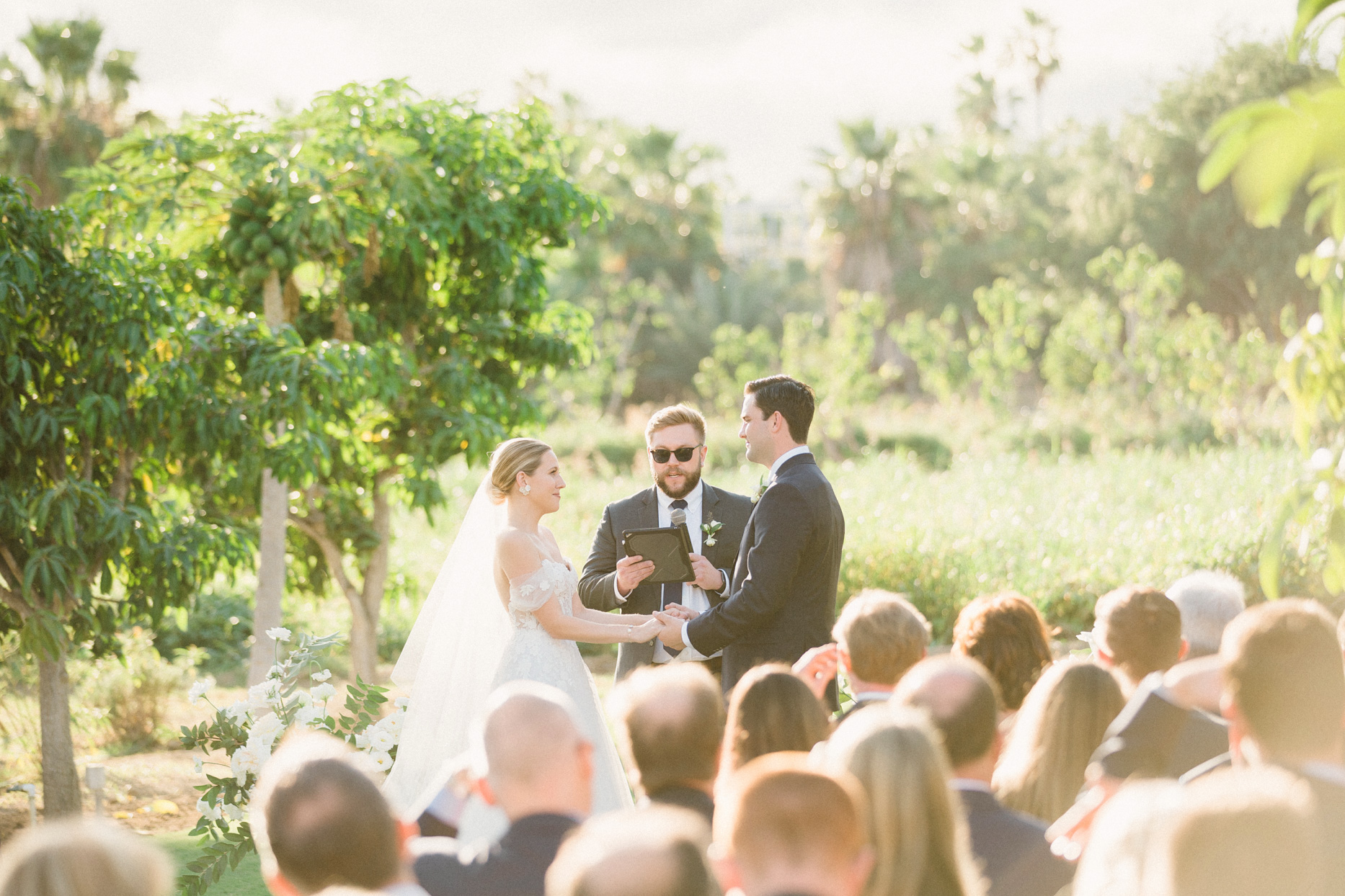 wedding ceremony couple holding hands during golden hour