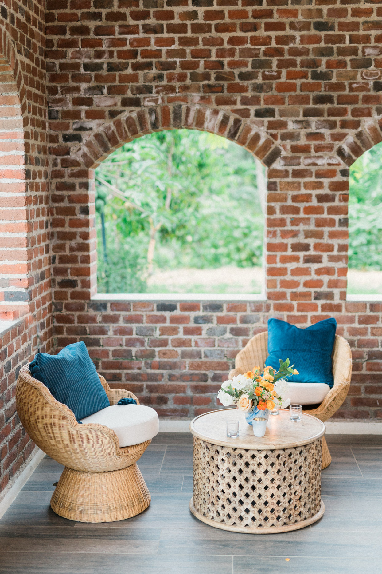 wicker chairs and table in wedding lounge area