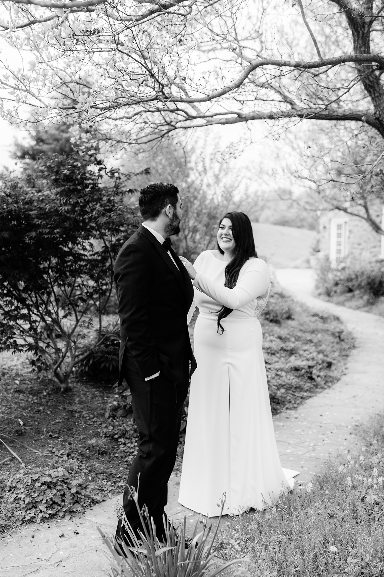 Groom and bride during first look in garden