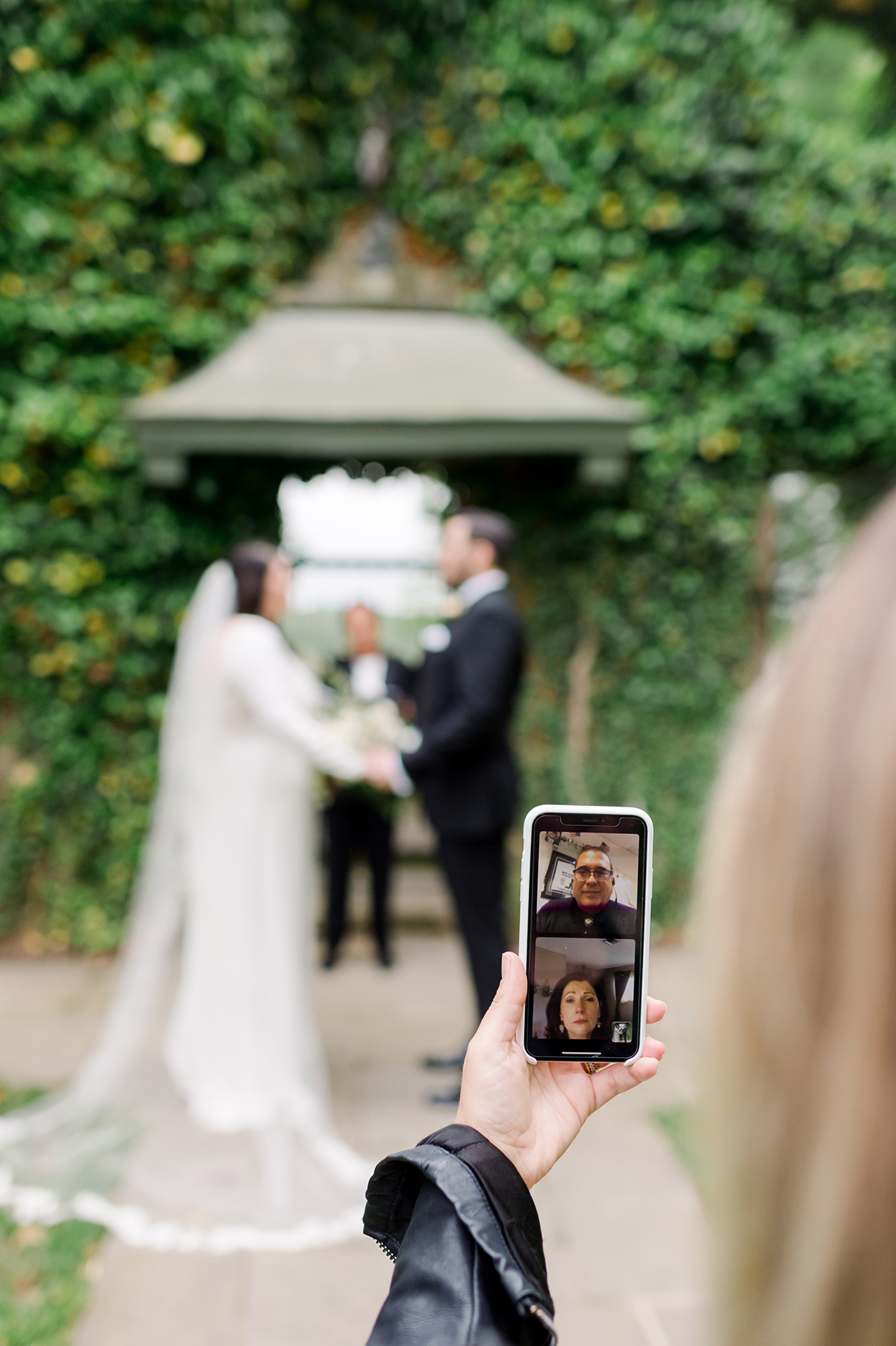 Parents of the bride watching ceremony via FaceTime
