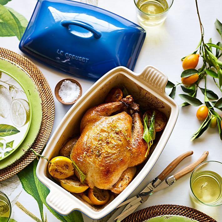 dinner scene with chicken in Le Creuset baker