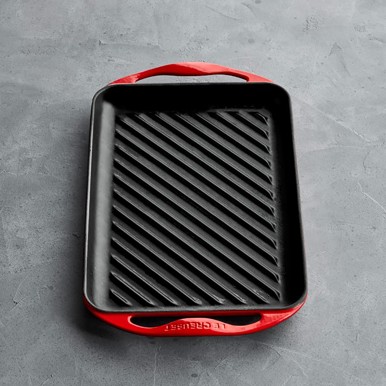 Le Creuset's skinny grill in red