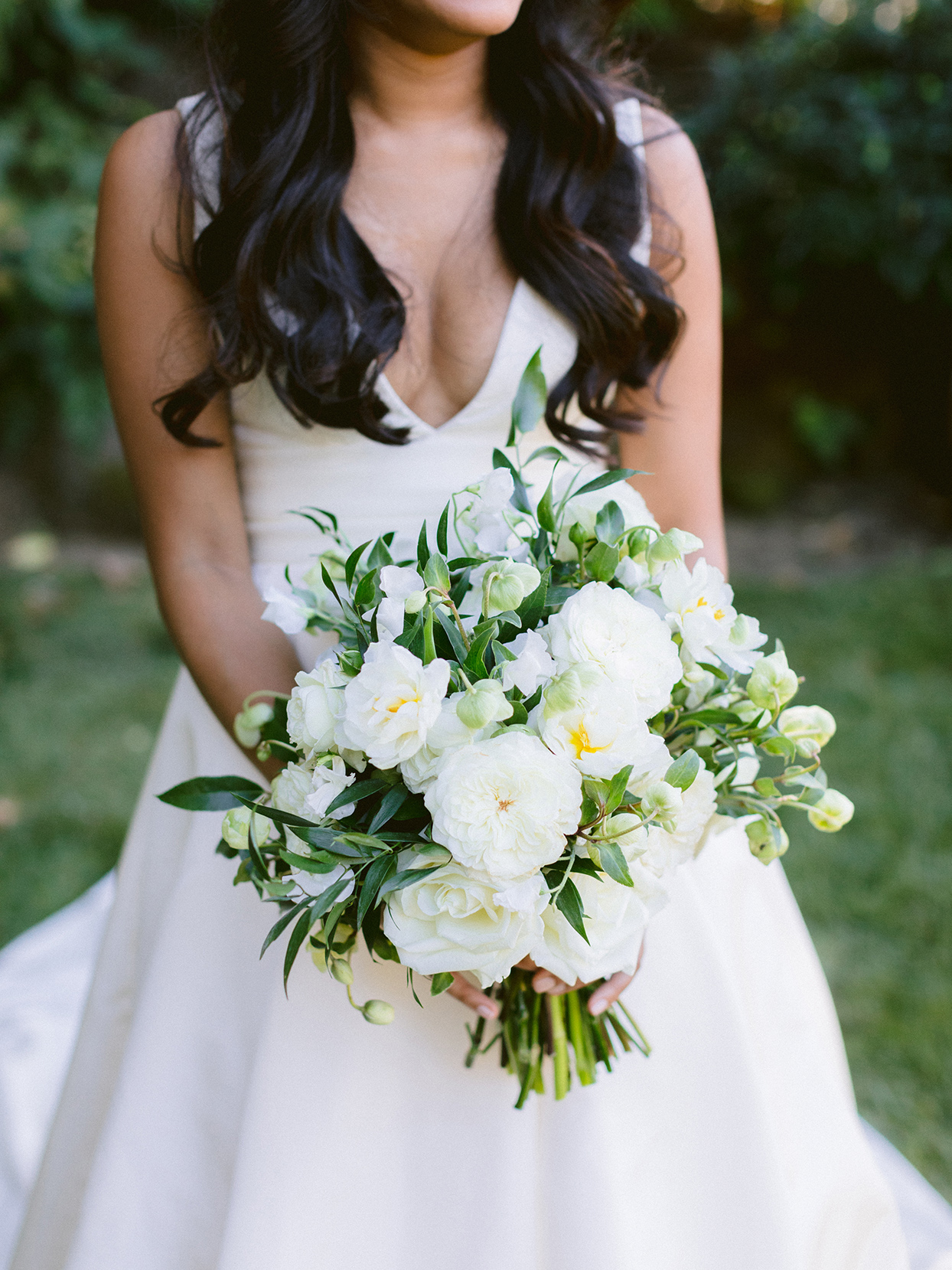 Bride in Silk Faille Vera Wang wedding dress and bouquet of white and cream flowers