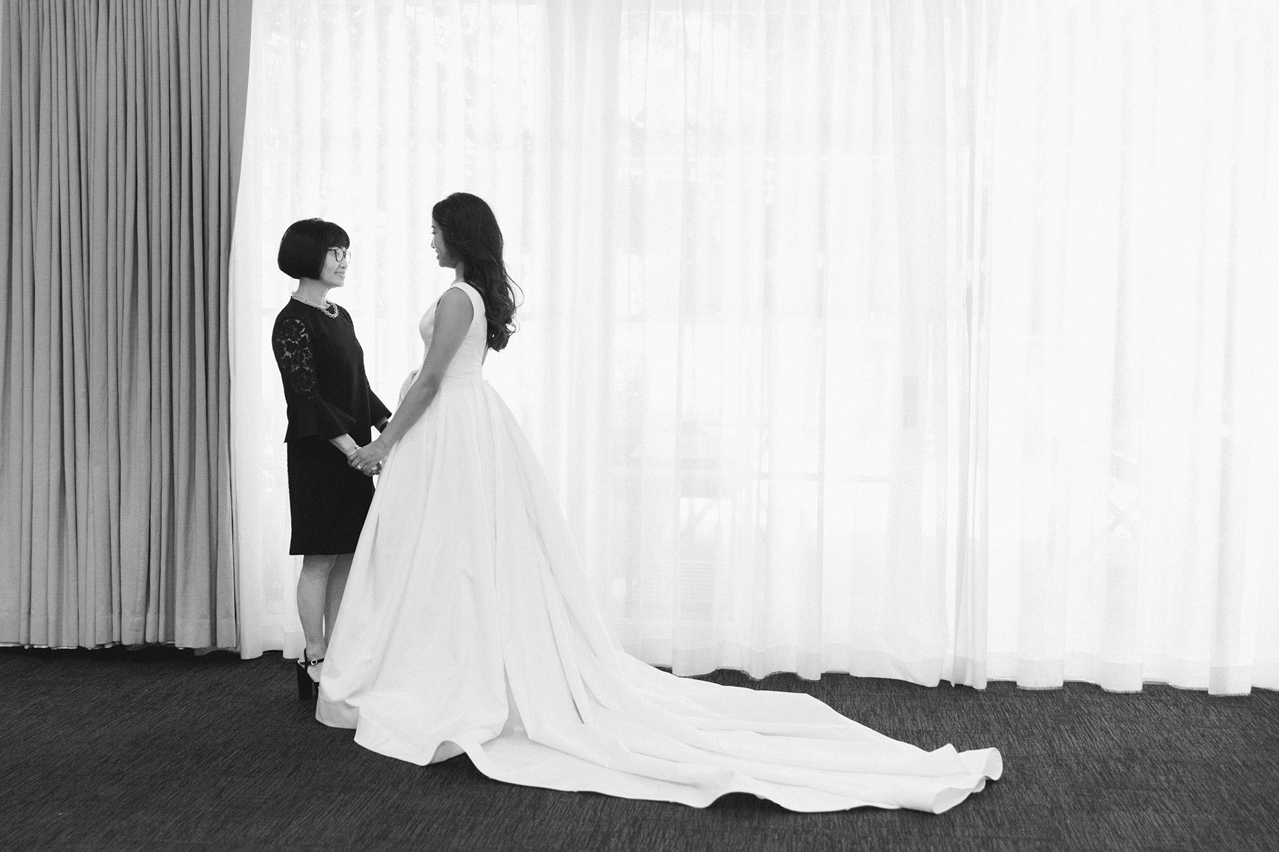 Bride holding hands with mother