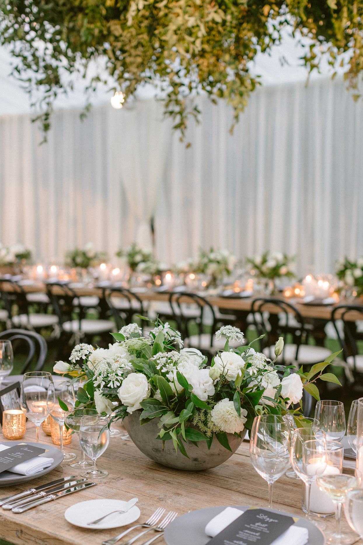 Floral centerpieces on long trestle table