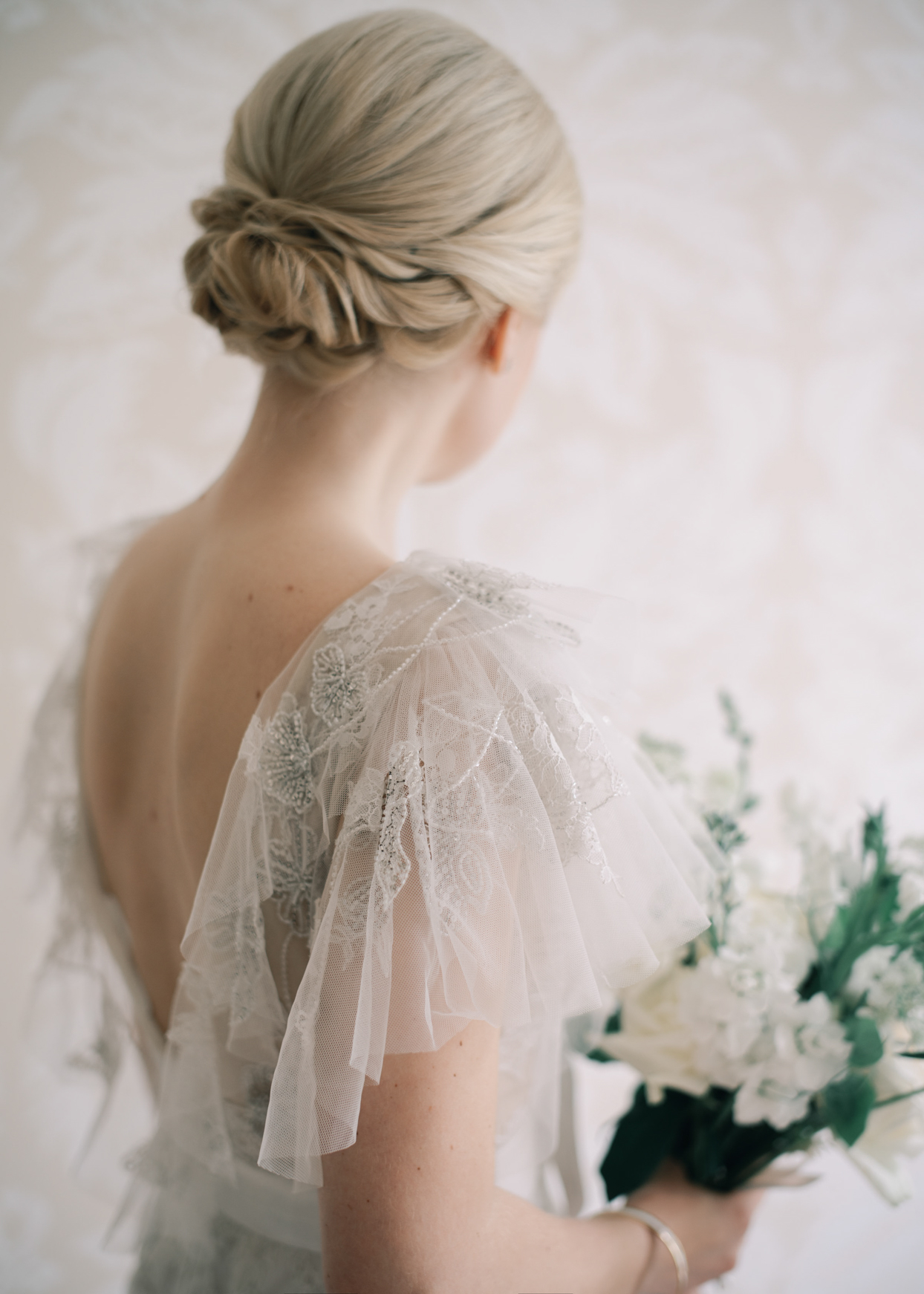 bride in airy while dress with floral wedding bouquet