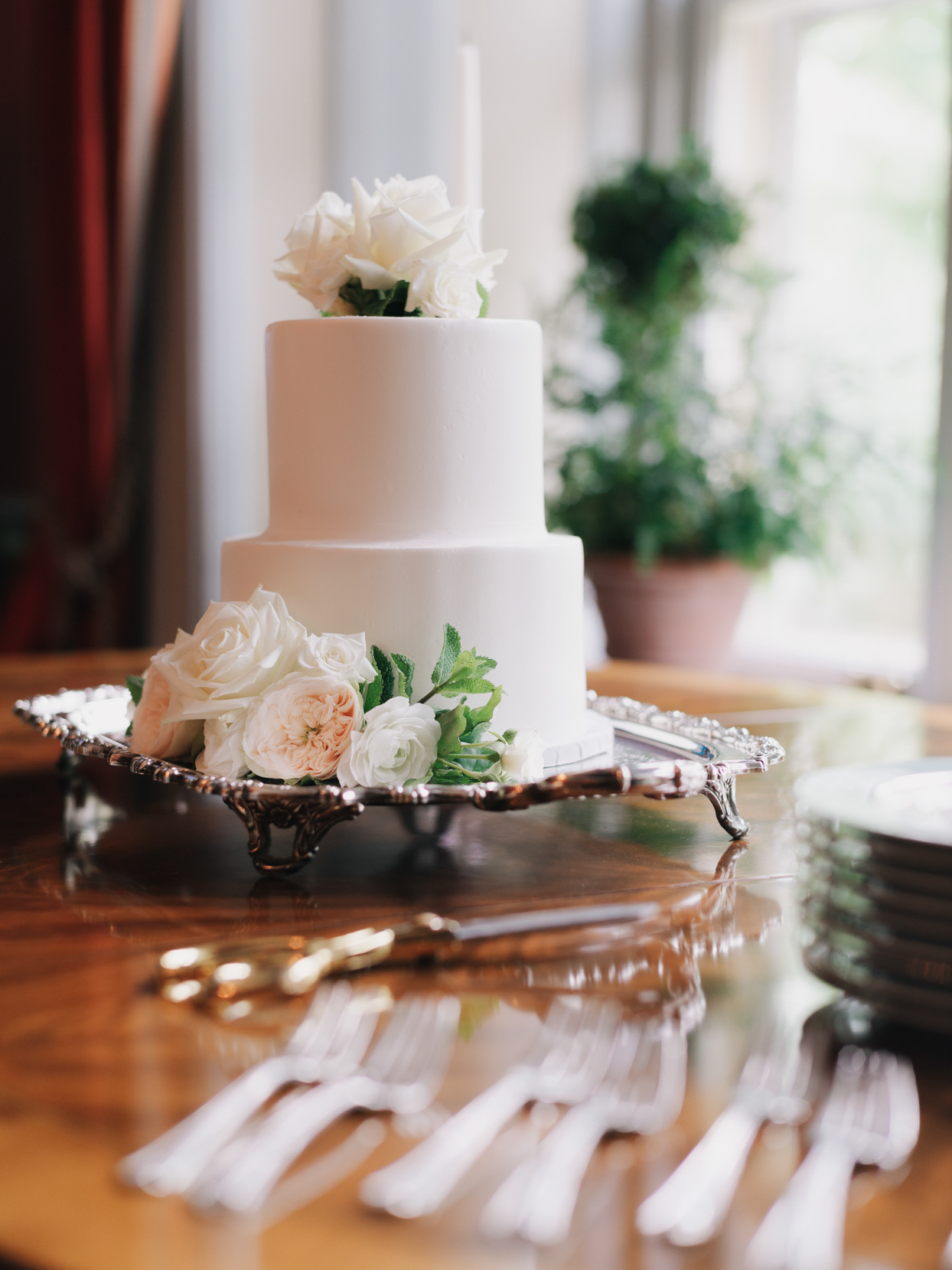 simple three tiered white wedding cake with flowers