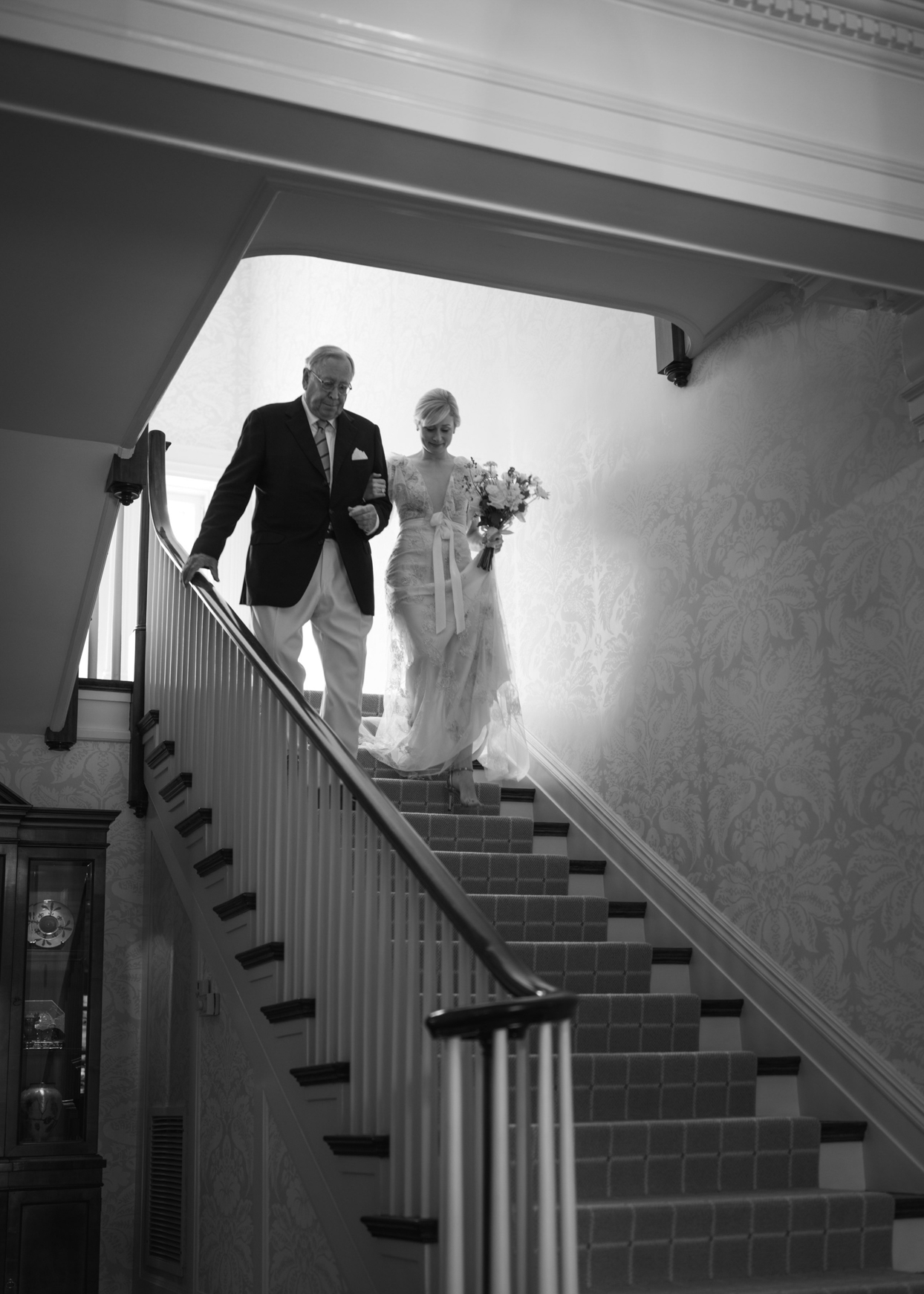bride and father walking downstairs wedding ceremony processional