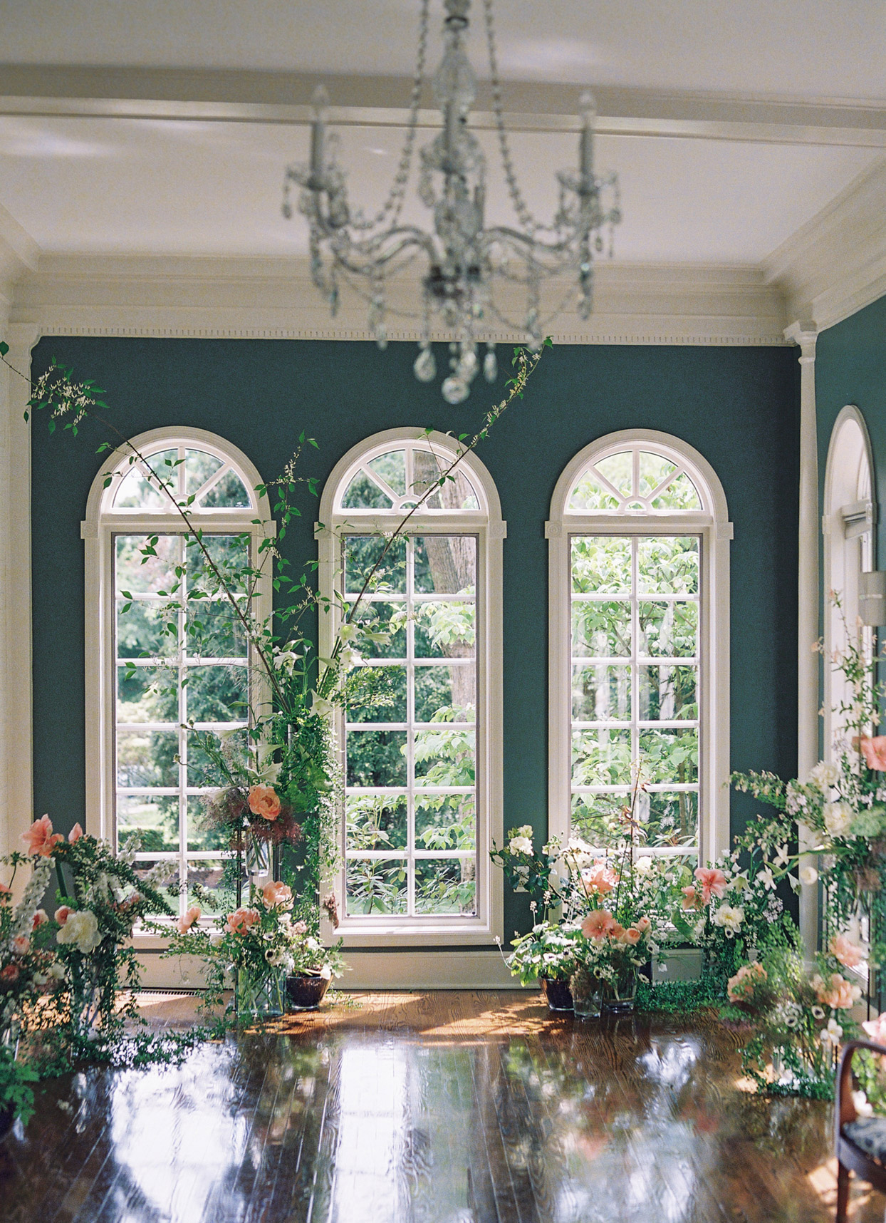 arched windows backdrop for wedding ceremony