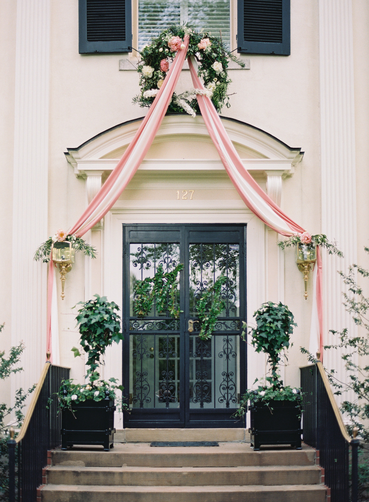 home front step decorating with wreath and drape for wedding