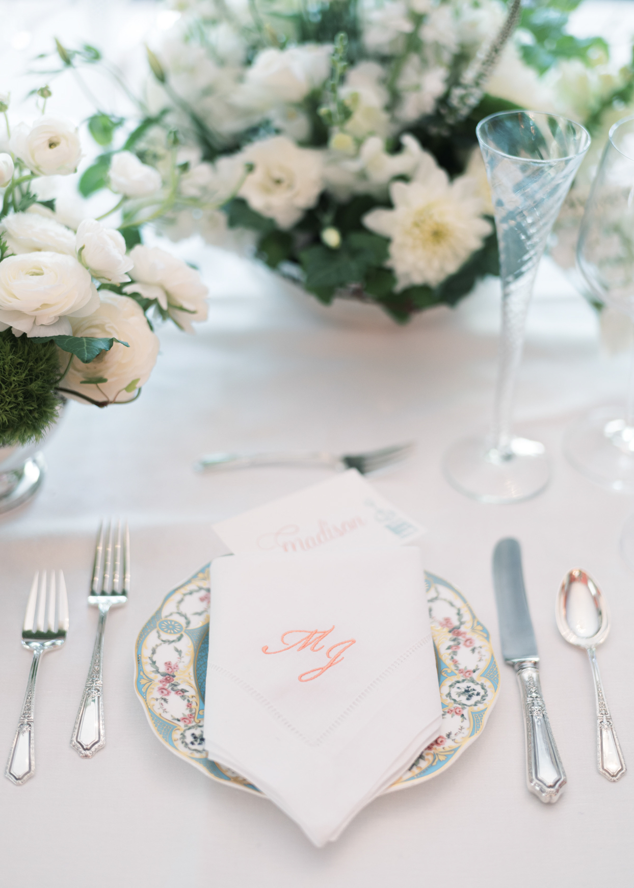 elegant wedding place setting with ornate plate and monogrammed napkin