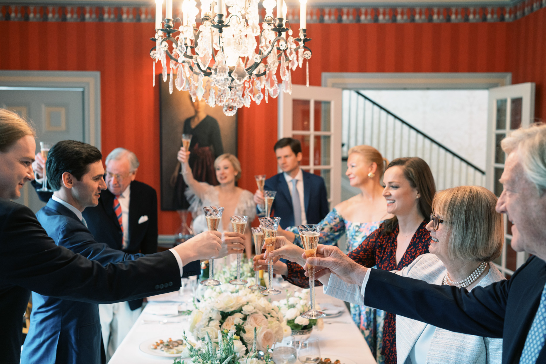 guests toasting around wedding table