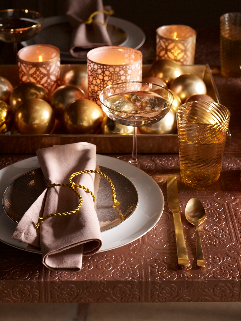 holiday place setting with votives