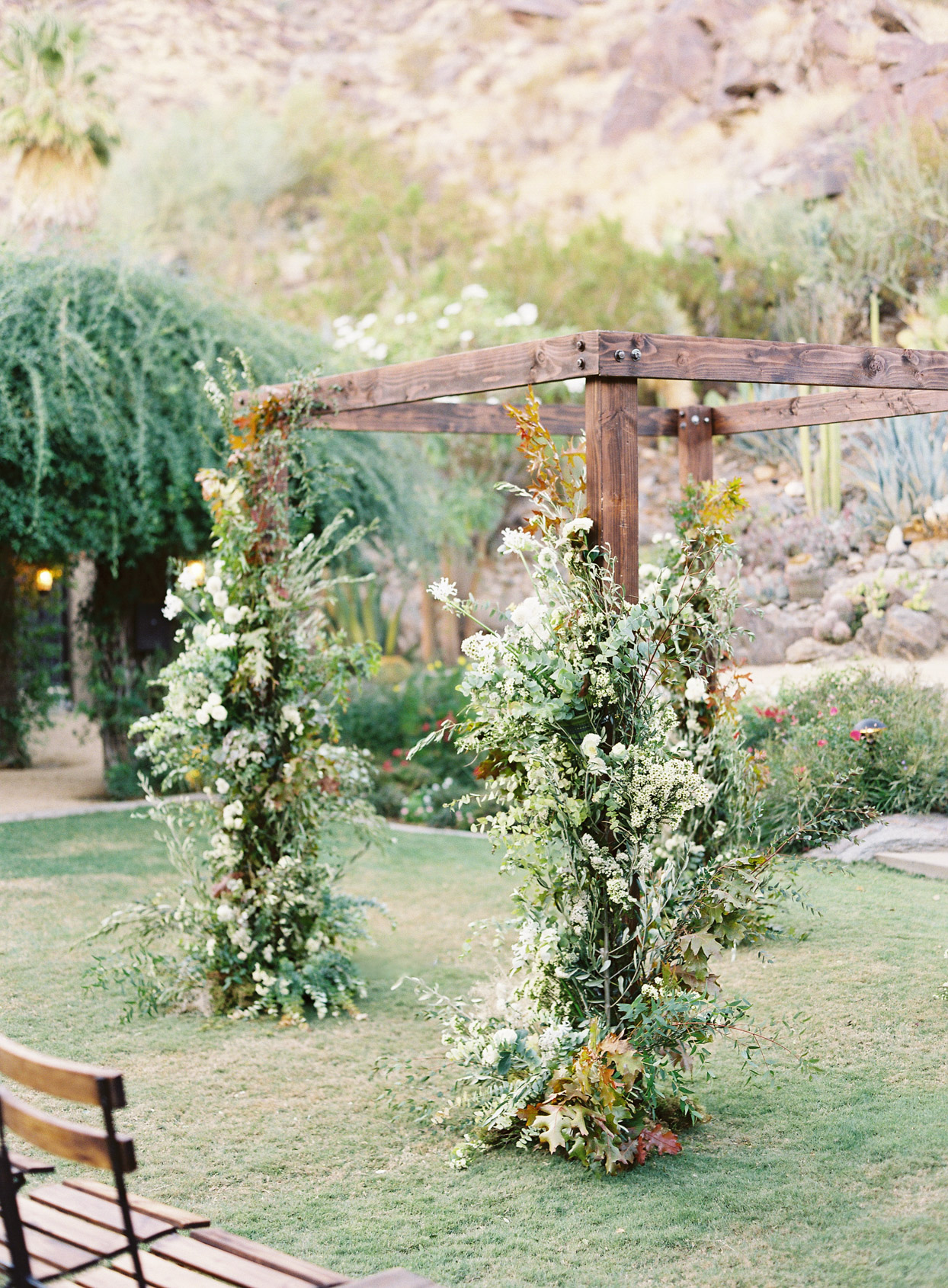 wooden wedding ceremony arch with floral decor