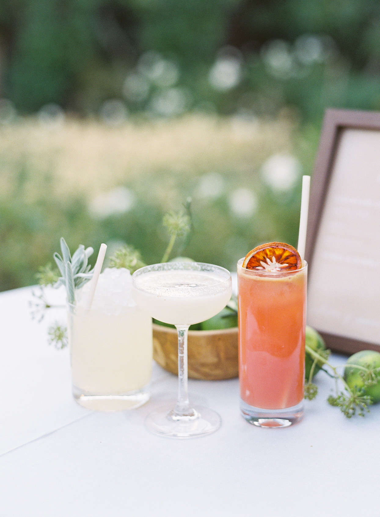 wedding cocktails on white linen table