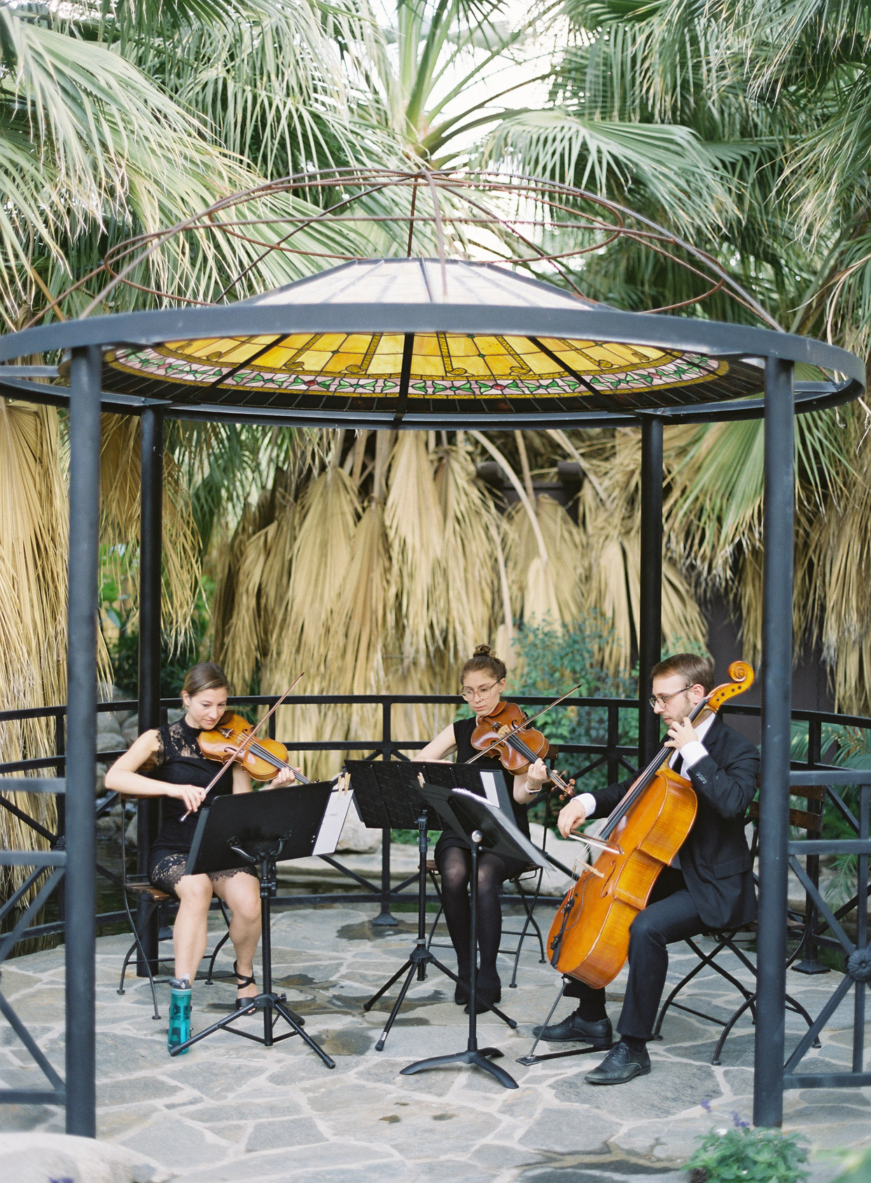 string trio playing music for wedding