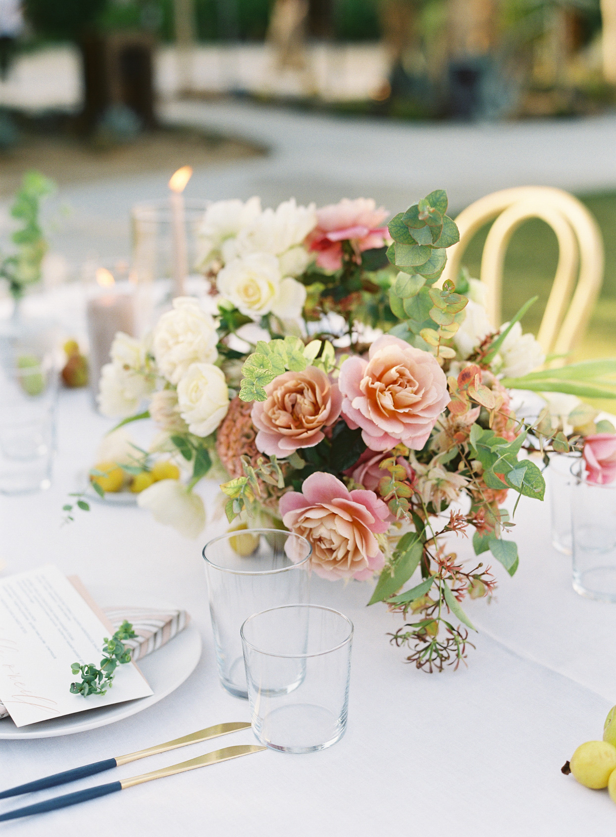 pink and orange toned floral centerpiece at reception