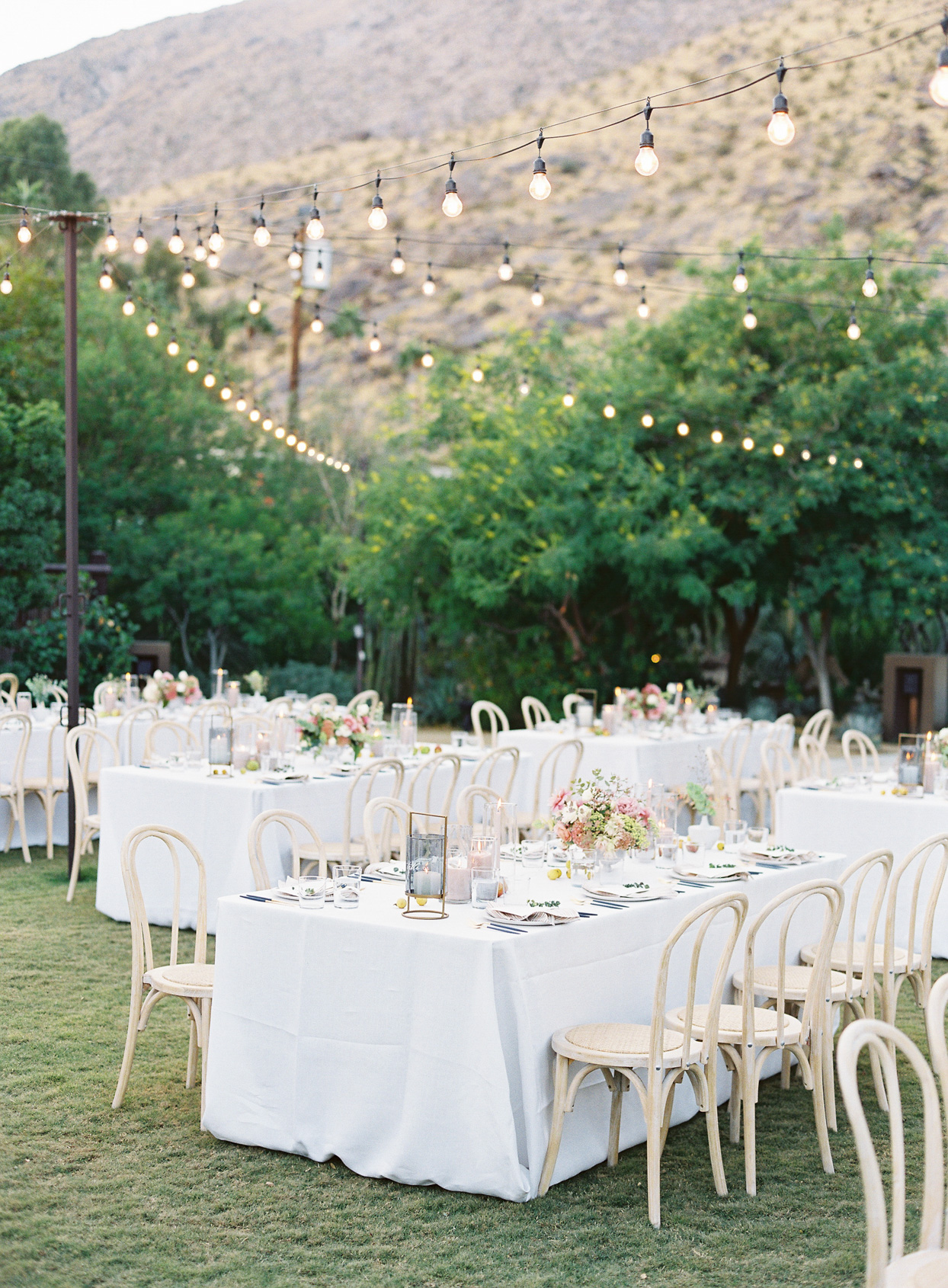wedding long tables with white linens for outdoor reception