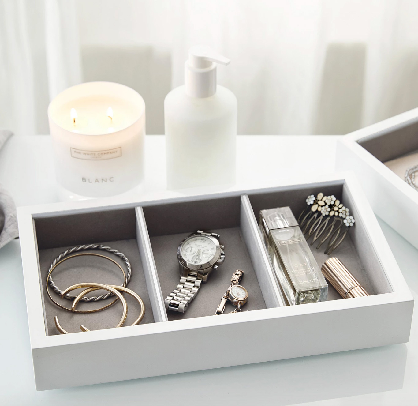 white box tray with three compartments