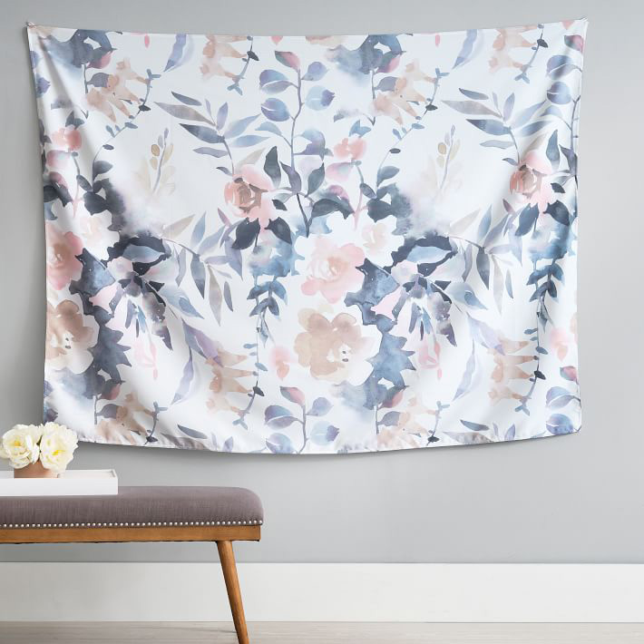 watercolor tapestry hanging on wall