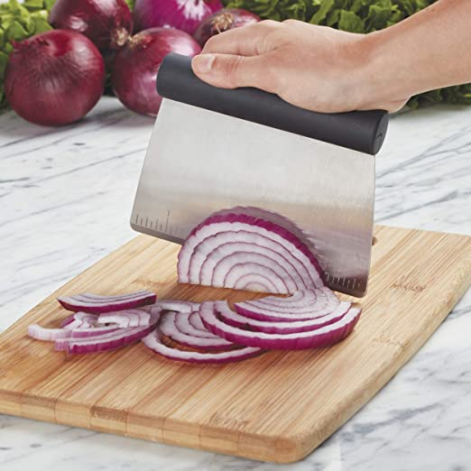 bench scraper moving sliced red onion