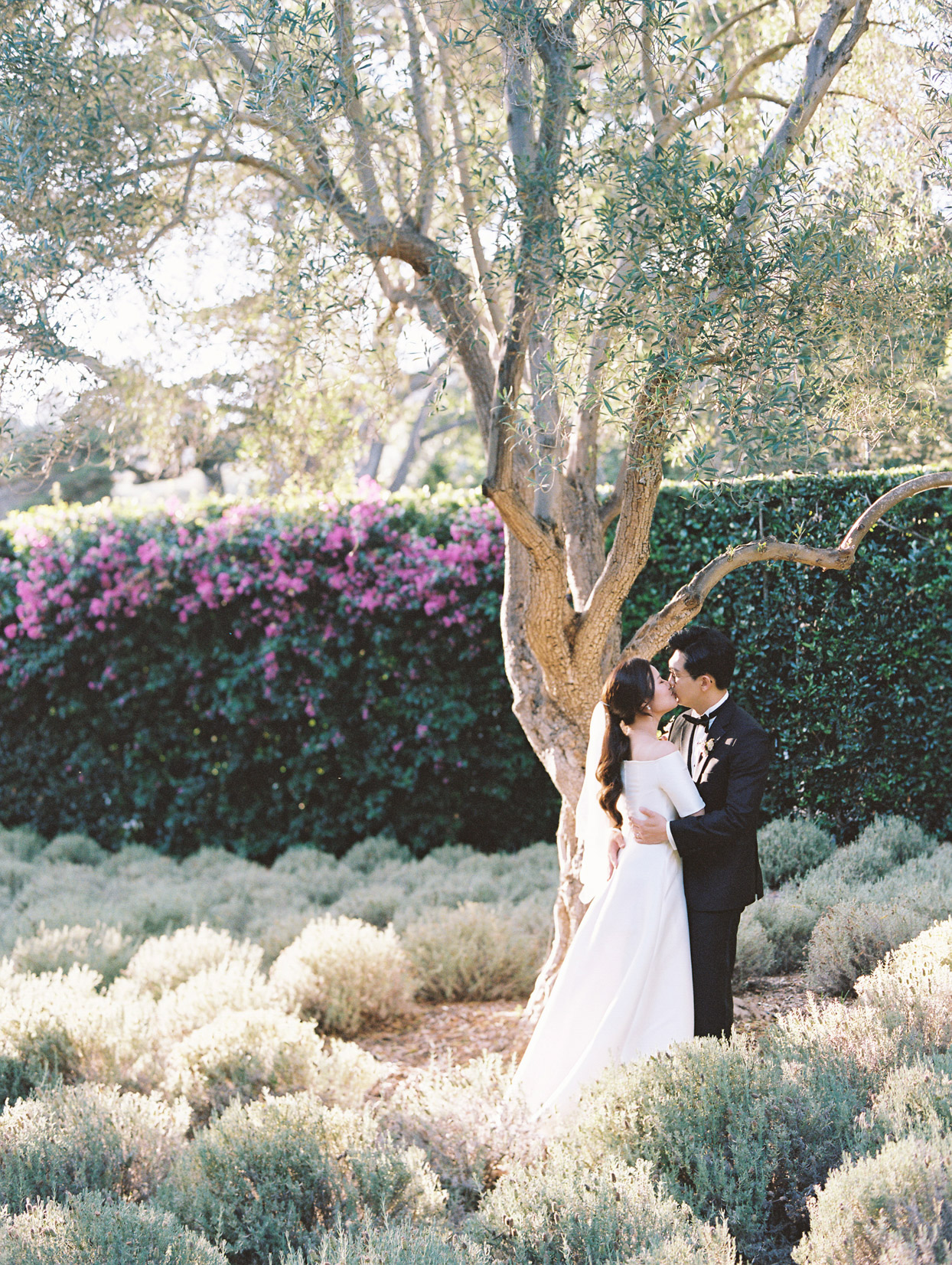 wedding couple kiss for portrait in garden