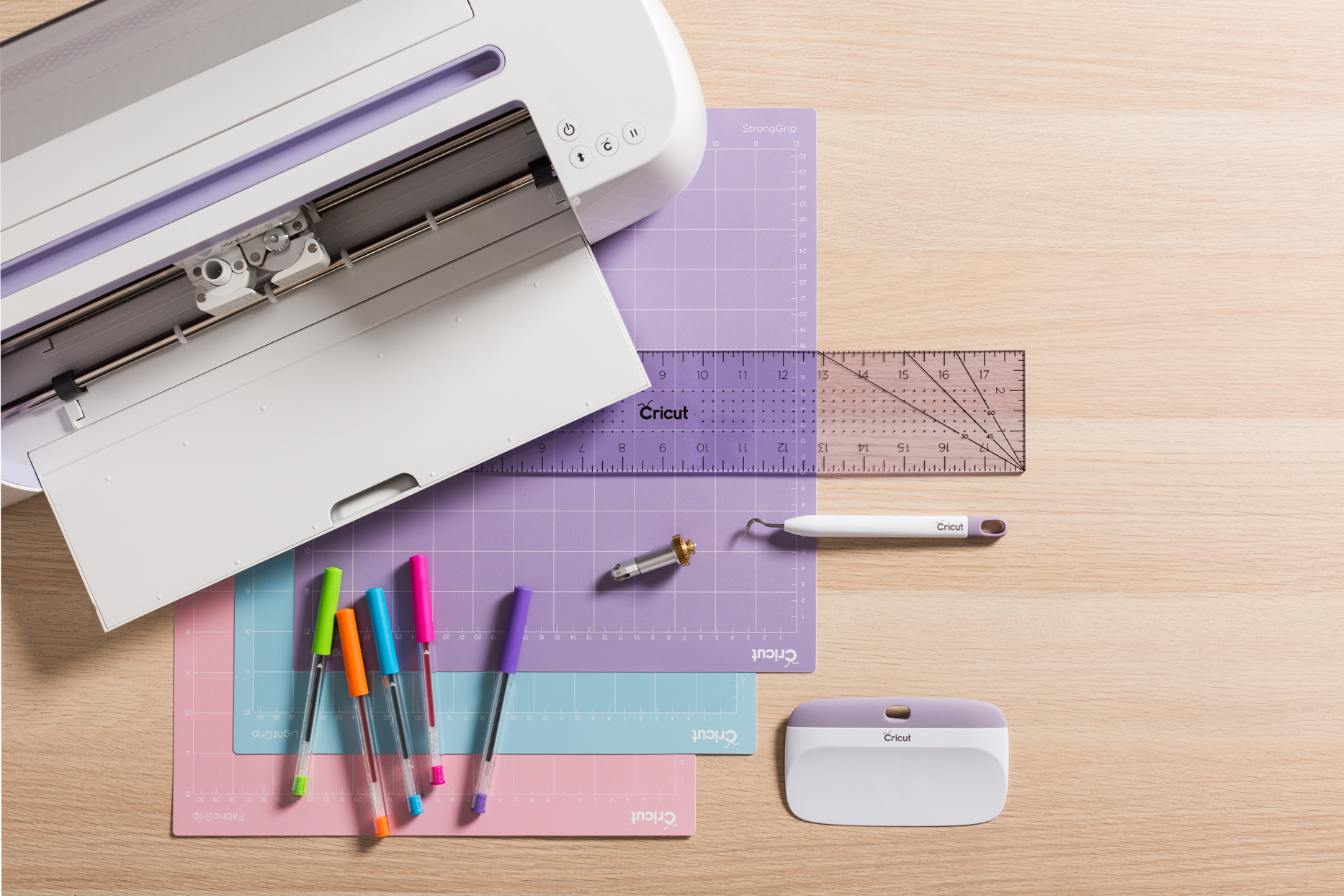 white cricut with colorful mats and other supplies