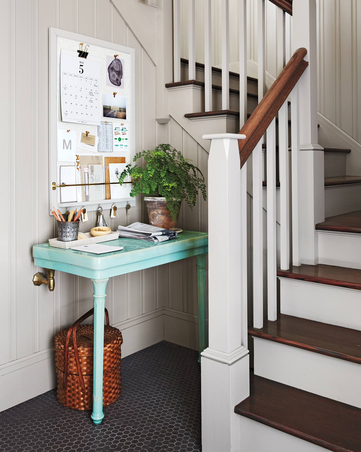 small teal desk in nook by stairway
