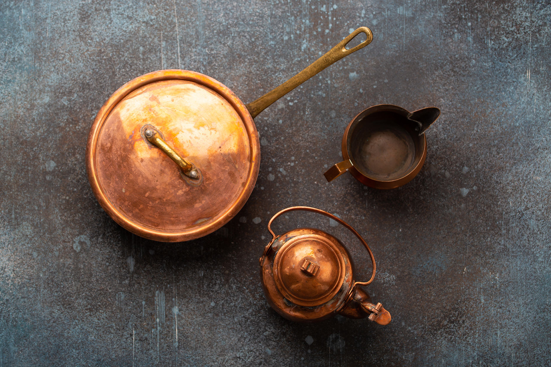 copper cookware on table