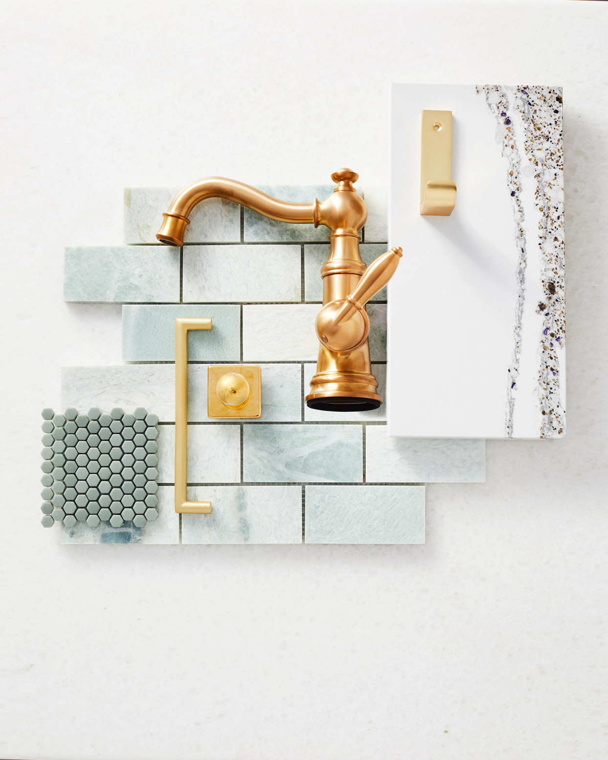bathroom fixture details in mint green, gold, and white