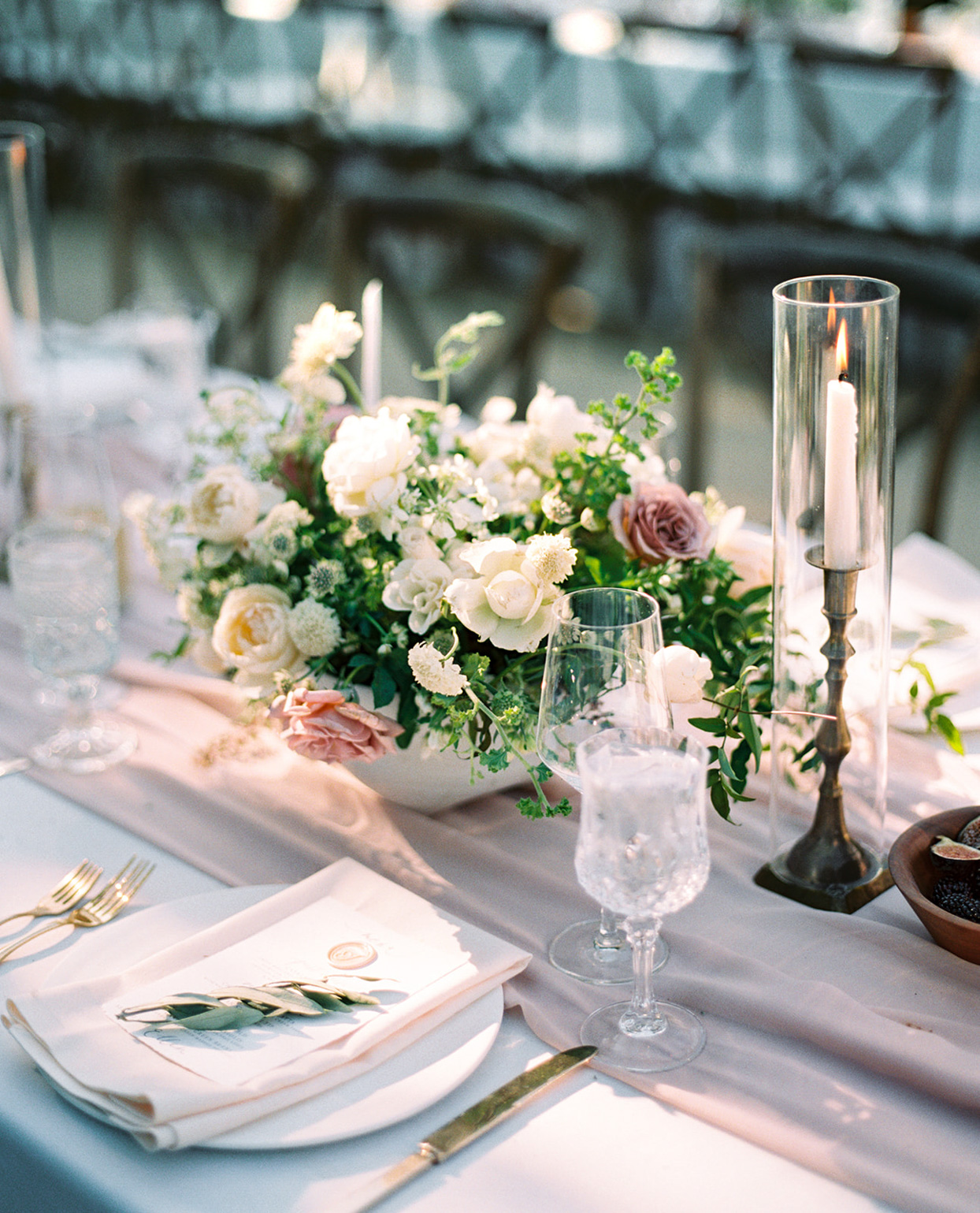pastel pink floral centerpieces on table
