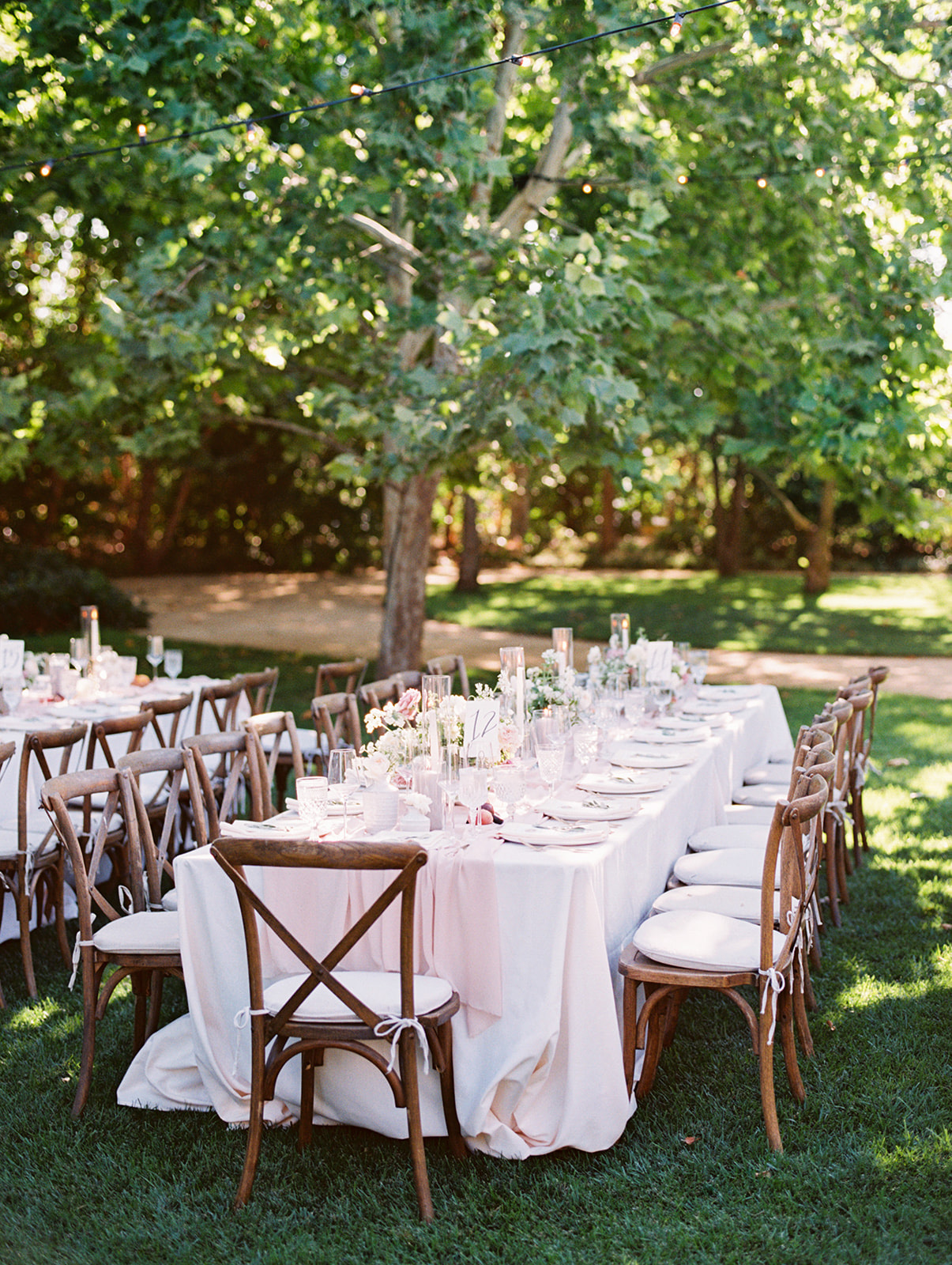 outdoor garden reception with pastel pink tables