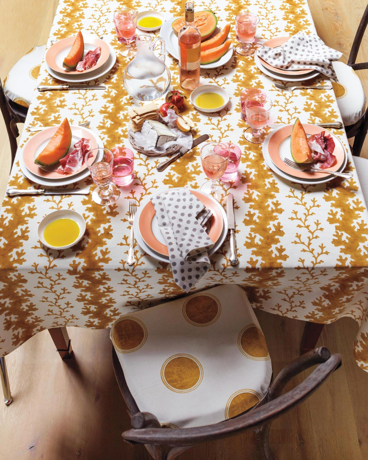 gold and white patterned table cloth and chairs
