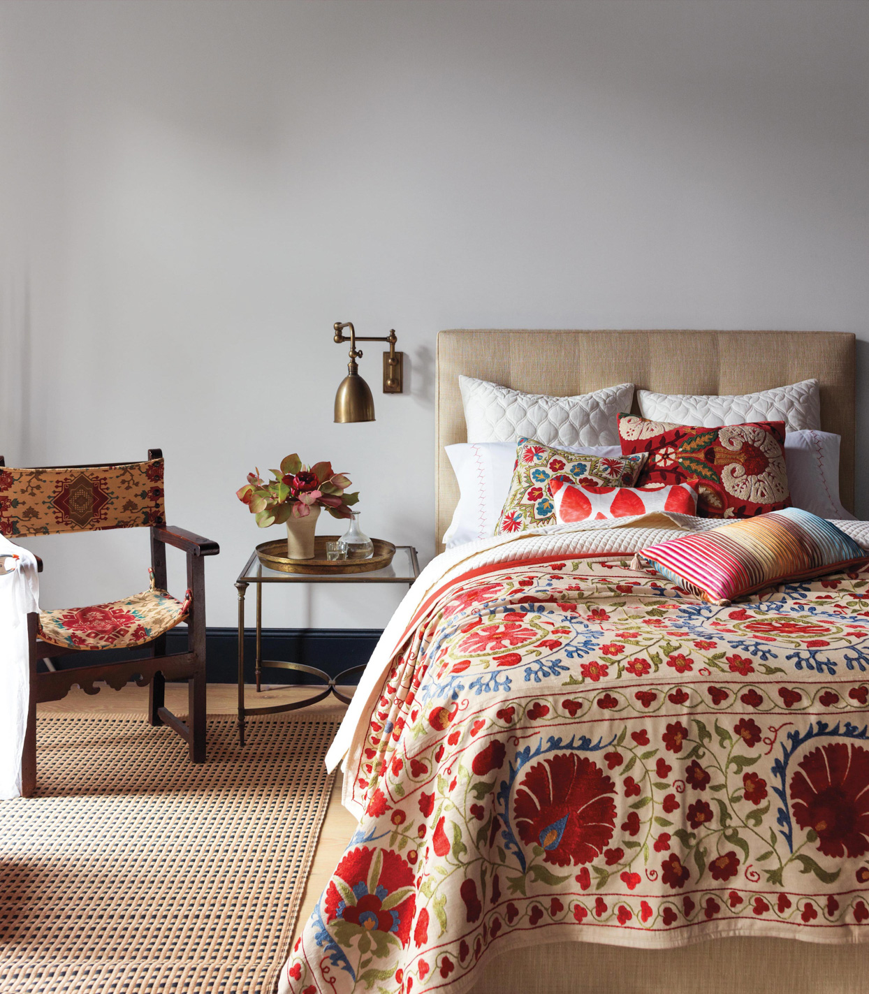 red and blue floral patterned textiles in bedroom