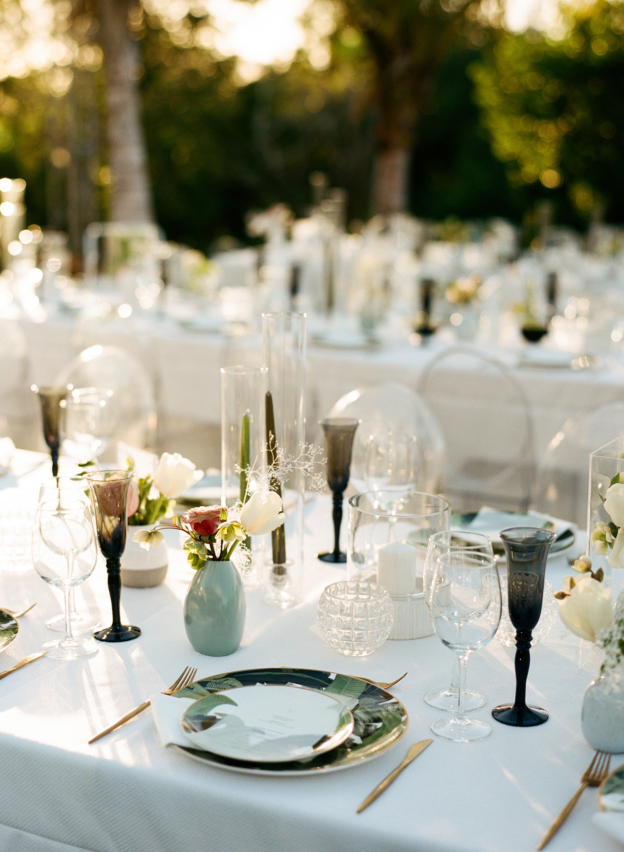 Wedding centerpieces of taper and pillar candles in white, black, and green