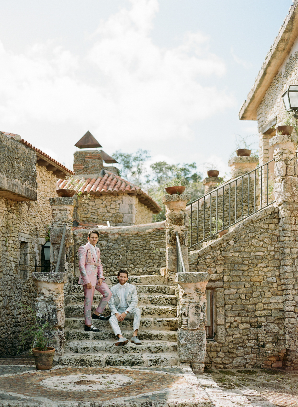 Grooms on stone steps